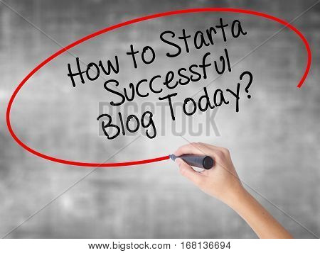 Woman Hand Writing How To Start A Successful Blog Today? With Black Marker Over Transparent Board