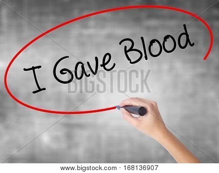 Woman Hand Writing I Gave Blood With Black Marker Over Transparent Board