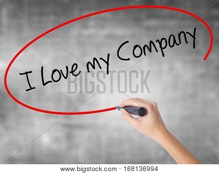Woman Hand Writing I Love My Company  With Black Marker Over Transparent Board