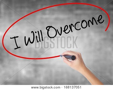 Woman Hand Writing I Will Overcome With Black Marker Over Transparent Board