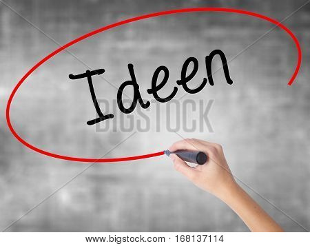 Woman Hand Writing Ideen (ideas In German)  With Black Marker Over Transparent Board
