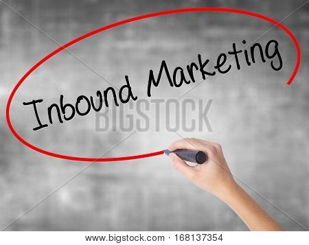 Woman Hand Writing Inbound Marketing  With Black Marker Over Transparent Board