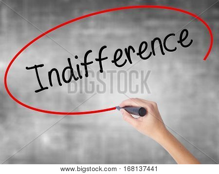 Woman Hand Writing Indifference  With Black Marker Over Transparent Board