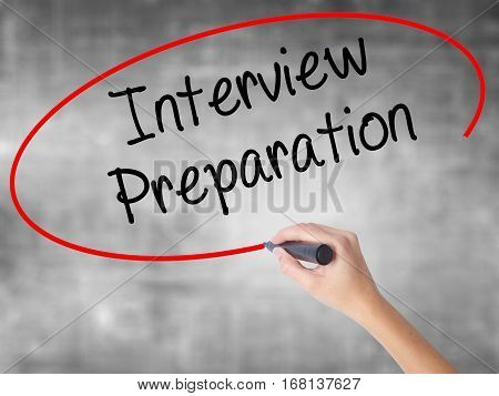 Woman Hand Writing Interview Preparation With Black Marker Over Transparent Board