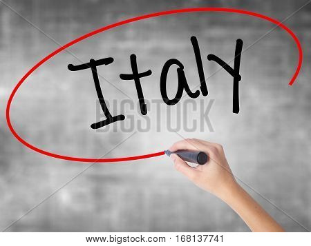 Woman Hand Writing Italy With Black Marker Over Transparent Board.