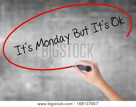 Woman Hand Writing It's Monday But It's Ok With Black Marker Over Transparent Board