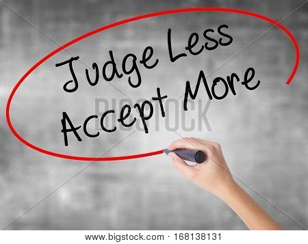Woman Hand Writing Judge Less Accept More With Black Marker Over Transparent Board