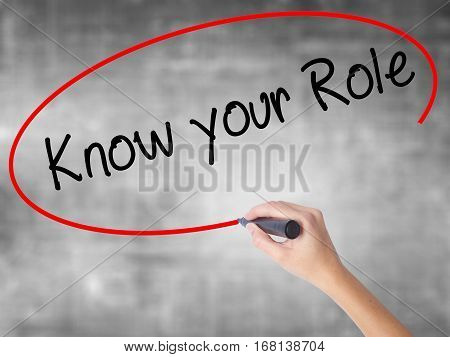 Woman Hand Writing Know Your Role  With Black Marker Over Transparent Board