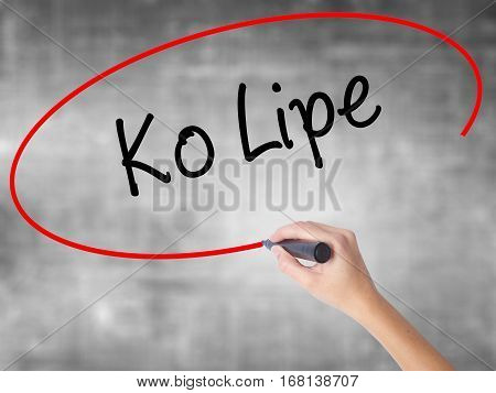 Woman Hand Writing Ko Lipe With Black Marker Over Transparent Board