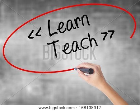 Woman Hand Writing Learn - Teach With Black Marker Over Transparent Board.