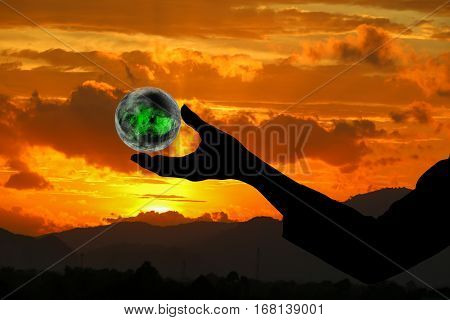 business man receiving hand shadow holding the world in palm of idea on sky red background