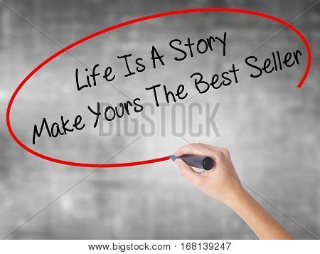 Woman Hand Writing Life Is A Story Make Yours The Best Seller With Black Marker Over Transparent Boa