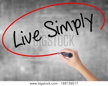 Woman Hand Writing Live Simply With Black Marker Over Transparent Board