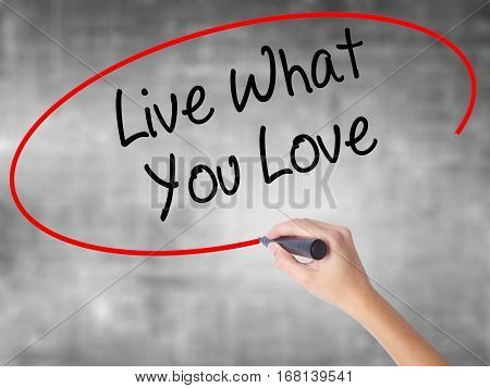 Woman Hand Writing Live What You Love  With Black Marker Over Transparent Board