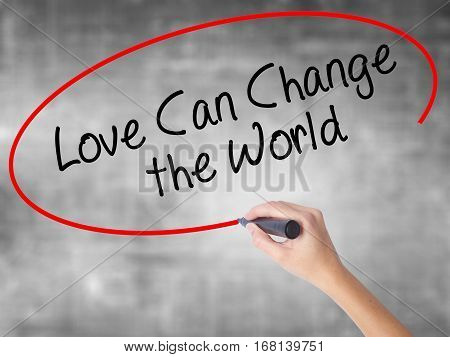 Woman Hand Writing Love Can Change The World With Black Marker Over Transparent Board