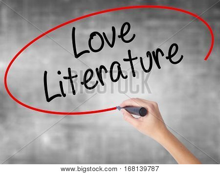 Woman Hand Writing Love Literature With Black Marker Over Transparent Board.
