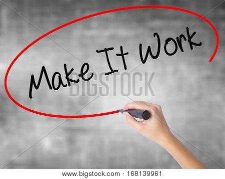 Woman Hand Writing Make It Work With Black Marker Over Transparent Board