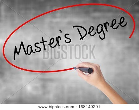 Woman Hand Writing Master's Degree With Black Marker Over Transparent Board.