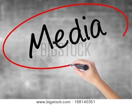 Woman Hand Writing Media With Black Marker Over Transparent Board