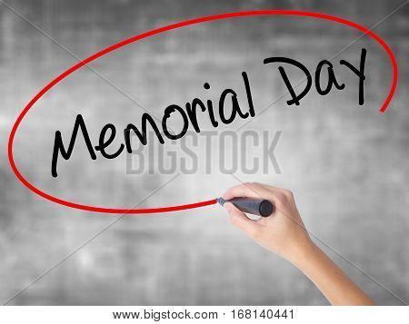 Woman Hand Writing Memorial Day With Black Marker Over Transparent Board.