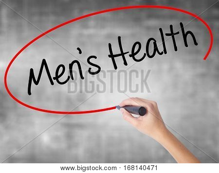 Woman Hand Writing Men's Health With Black Marker Over Transparent Board