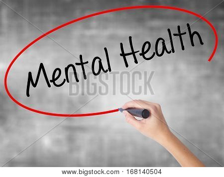 Woman Hand Writing Mental Health With Black Marker Over Transparent Board