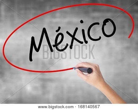 Woman Hand Writing Mexico (in Spanish) With Black Marker Over Transparent Board.
