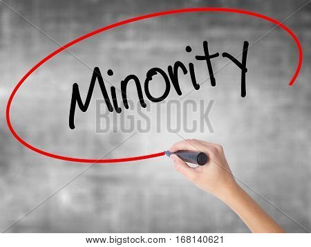 Woman Hand Writing Minority With Black Marker Over Transparent Board