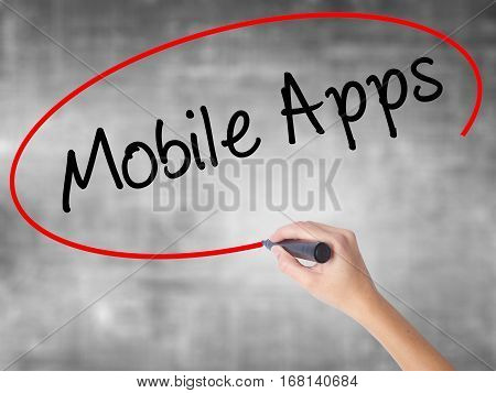 Woman Hand Writing Mobile Apps With Black Marker Over Transparent Board