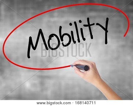 Woman Hand Writing Mobility With Black Marker Over Transparent Board
