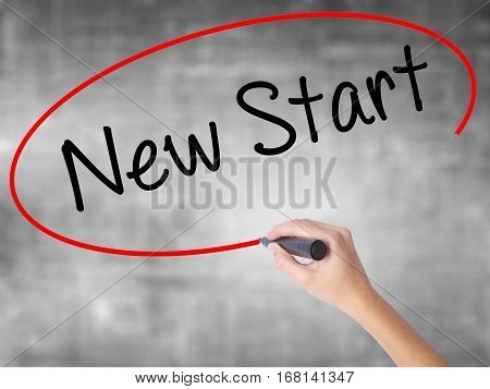 Woman Hand Writing New Start With Black Marker Over Transparent Board