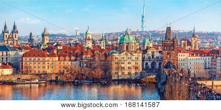 Old town of Prague. Czech Republic over river Vltava with cathedral and Charles bridge on skyline. Bright sunny day blue sky. Praha panorama landscape view.