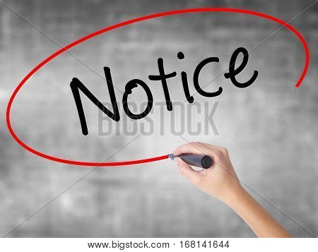 Woman Hand Writing Notice With Black Marker Over Transparent Board