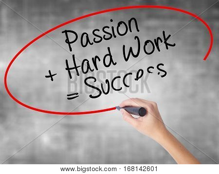 Woman Hand Writing Passion + Hard Work = Success With Black Marker Over Transparent Board