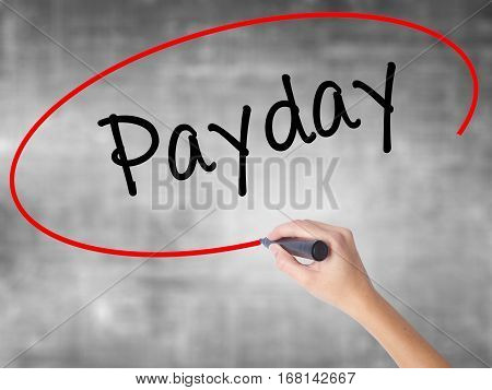 Woman Hand Writing Payday With Black Marker Over Transparent Board