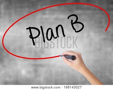 Woman Hand Writing Plan B With Black Marker Over Transparent Board