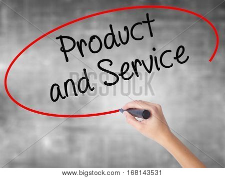 Woman Hand Writing Product And Service With Black Marker Over Transparent Board.
