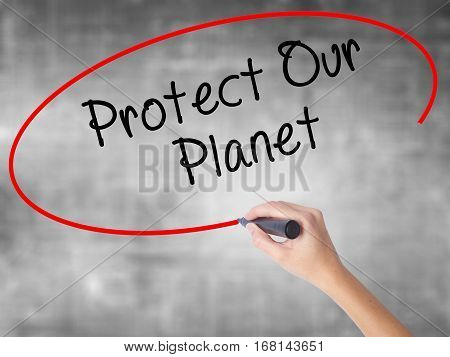 Woman Hand Writing Protect Our Planet With Black Marker Over Transparent Board