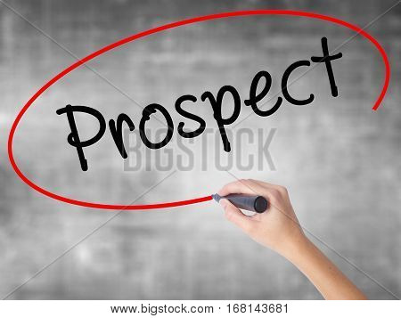 Woman Hand Writing Prospect With Black Marker Over Transparent Board