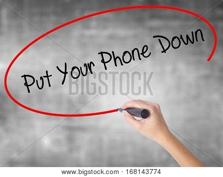 Woman Hand Writing Put Your Phone Down With Black Marker Over Transparent Board
