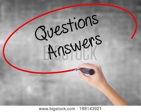 Woman Hand Writing Questions Answers With Black Marker Over Transparent Board