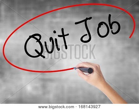 Woman Hand Writing Quit Job With Black Marker Over Transparent Board