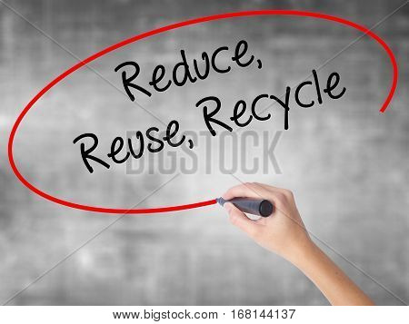 Woman Hand Writing Reduce Reuse Recycle With Black Marker Over Transparent Board.