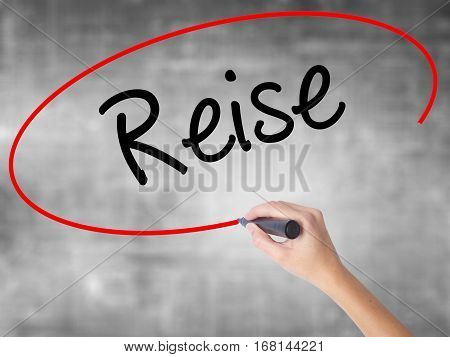 Woman Hand Writing Reise  (travel In German) With Black Marker Over Transparent Board