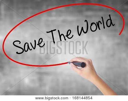 Woman Hand Writing Save The World With Black Marker Over Transparent Board.