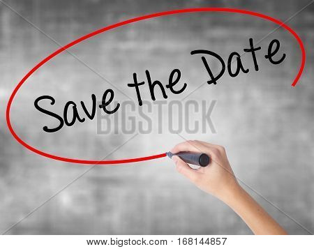 Woman Hand Writing Save The Date  With Black Marker Over Transparent Board