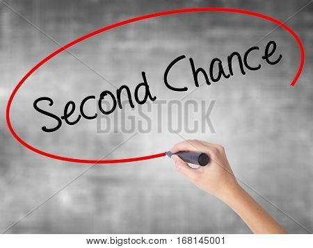 Woman Hand Writing Second Chance With Black Marker Over Transparent Board