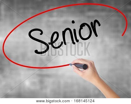 Woman Hand Writing Senior With Black Marker Over Transparent Board