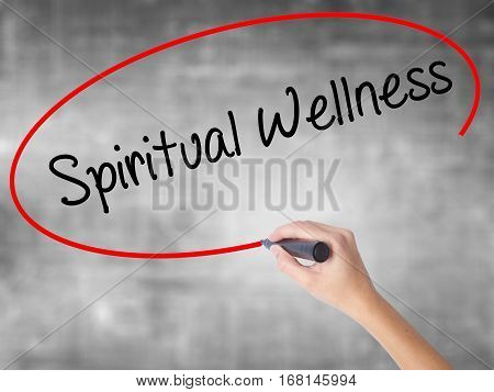 Woman Hand Writing Spiritual Wellness With Black Marker Over Transparent Board