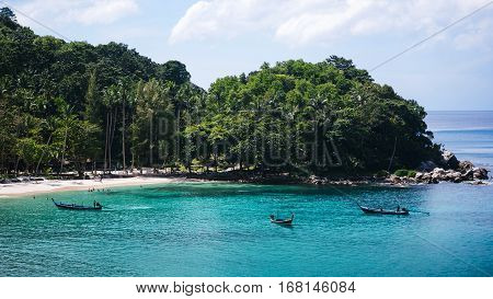 Beautiful tropical beach. Thai boat at the beach. Hot summer day at sea. The long-awaited vacation in the tropics